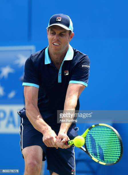 Sam Querry of The United States plays a backhand during the mens singles quarter final match against Gilles Muller of Luxembourg on day five of the...