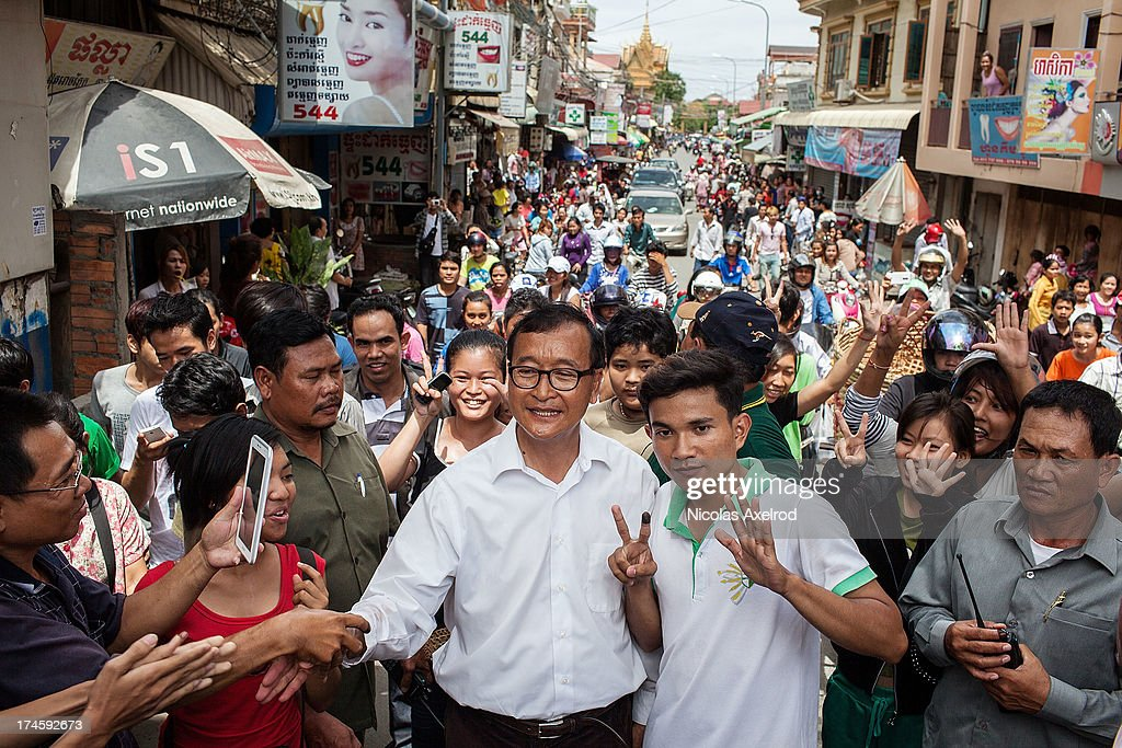 Sam Rainsy leader of the Cambodia National Rescue Party visits a market in Phnom Penh during the Cambodian general elections on July 28 2013 in Phnom...