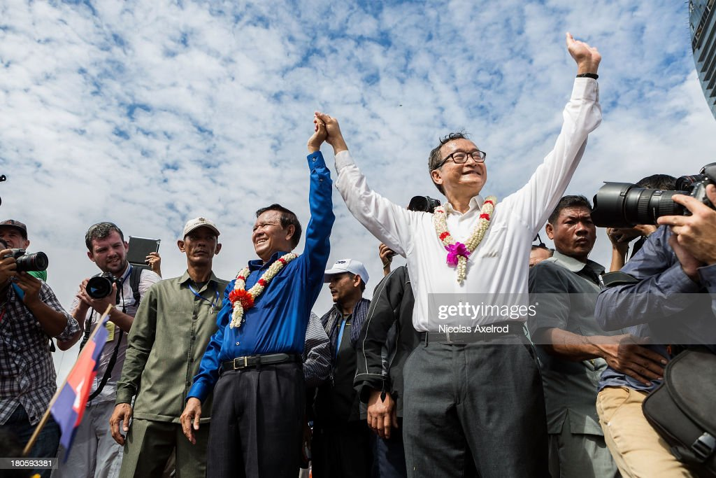 <a gi-track='captionPersonalityLinkClicked' href=/galleries/search?phrase=Sam+Rainsy&family=editorial&specificpeople=660347 ng-click='$event.stopPropagation()'>Sam Rainsy</a> (R), President, and Kem Sokha, Vice President of the Cambodia National Rescue Party, address the crowds at Freedom Park on September 15, 2013 in Phnom Penh, Cambodia. The CNRP have planned a three-day demonstration in Freedom Park to contest the Cambodian national election results.