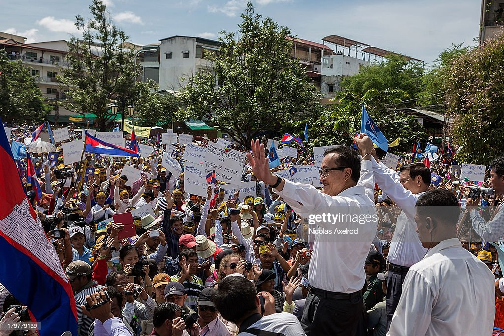 Sam Rainsy President and Kem Sokha VicePresident of the Cambodia National Rescue Party with supporters in Freedom Park on September 7 2013 in Phnom...