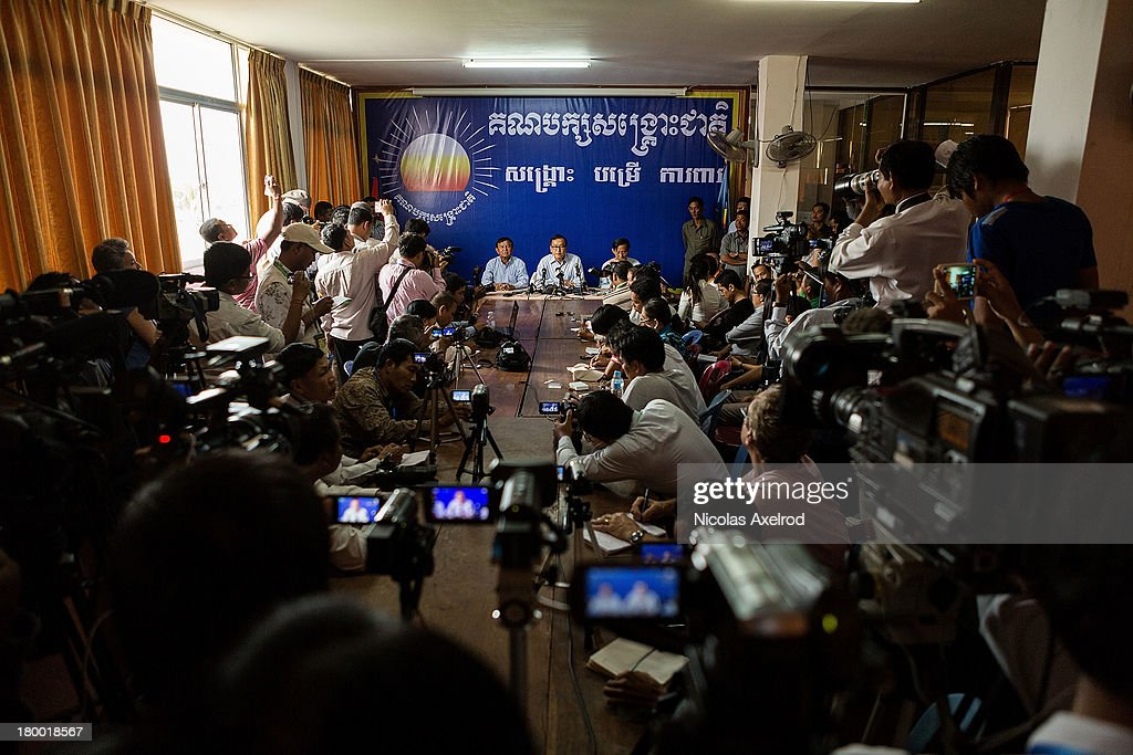 Sam Rainsy President and Kem Sokha VicePresident of the Cambodia National Rescue Party talk to members of the press at the party headquarters hours...