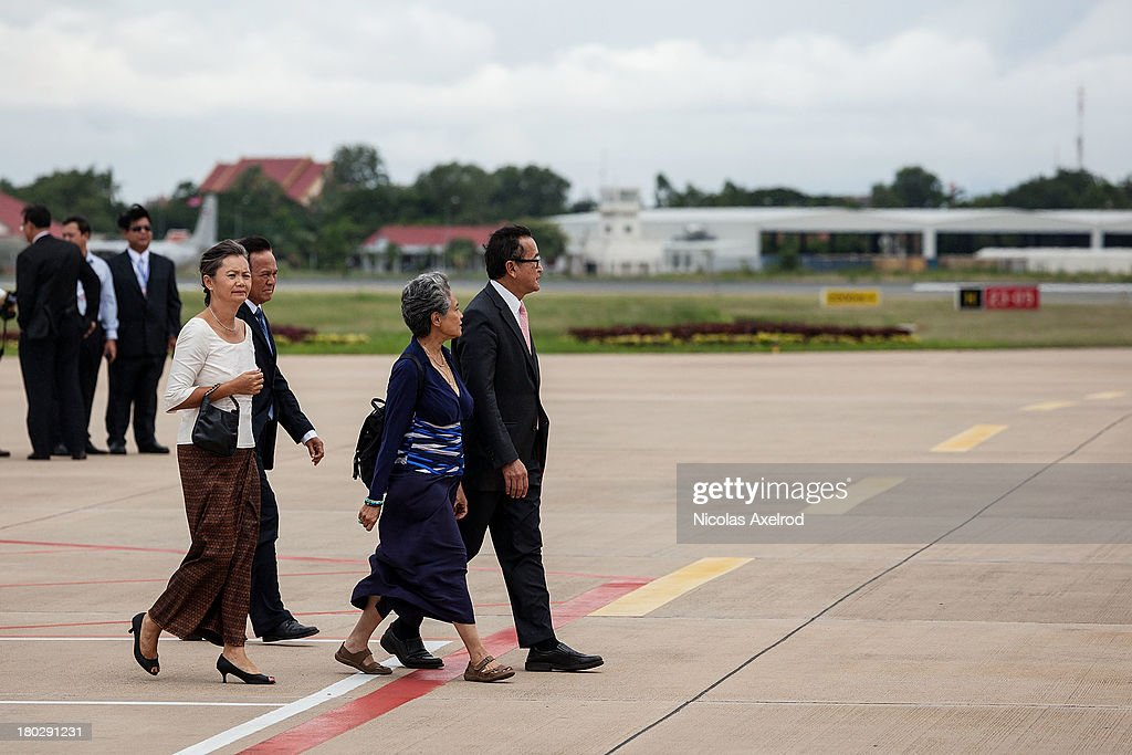 <a gi-track='captionPersonalityLinkClicked' href=/galleries/search?phrase=Sam+Rainsy&family=editorial&specificpeople=660347 ng-click='$event.stopPropagation()'>Sam Rainsy</a> president of the Cambodia National Rescue Party arrives at the Phnom Penh airport to welcome King Norodom Sihamoni on September 11, 2013 in Phnom Penh, Cambodia. King Norodom Sihamoni returns to Cambodia amid election controversy and has been asked by the opposition leader to intervene in the election dispute. The King had been in China where it is said he was receiving a medical check up.