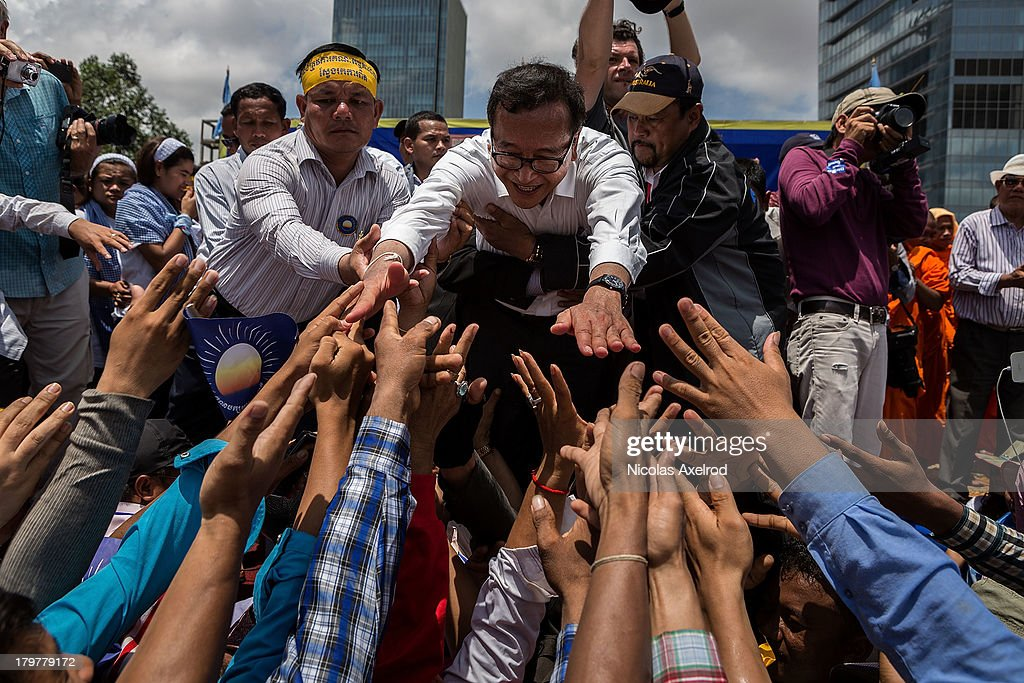 Sam Rainsy President of the Cambodia National Rescue Party greets supporters in Freedom Park on September 7 2013 in Phnom Penh Cambodia Thousands of...