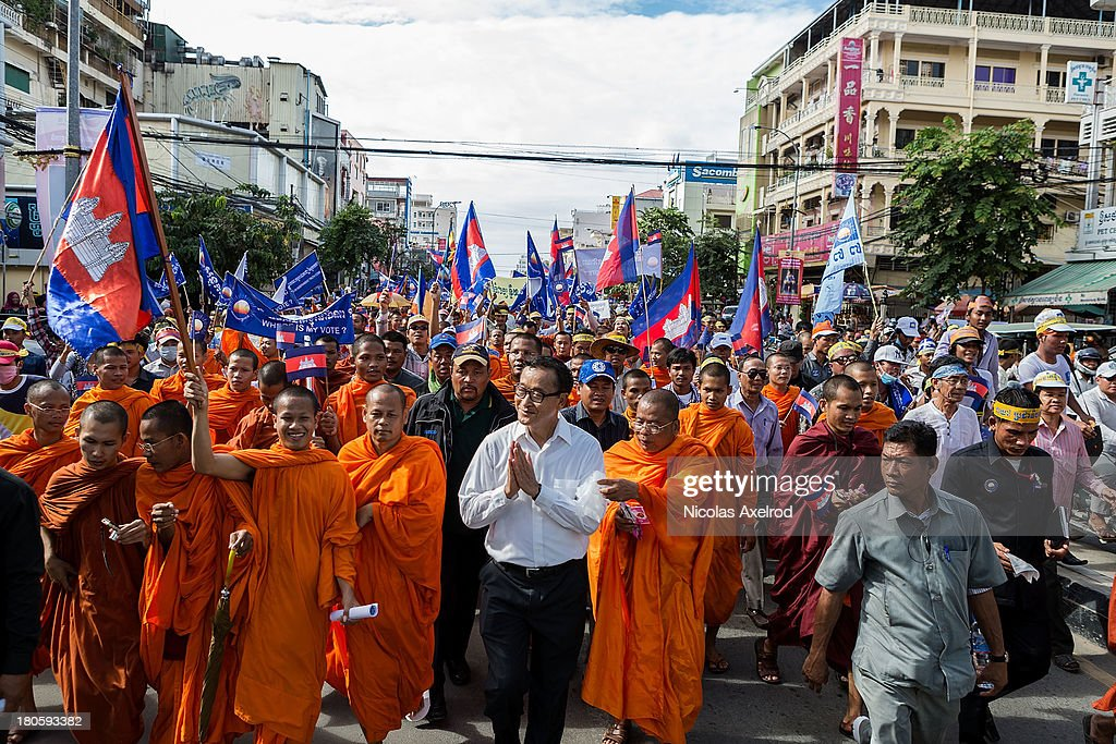 Sam Rainsy President of the Cambodia National Rescue Party marches to Freedom Park to contest the Cambodian national election results on September 15...