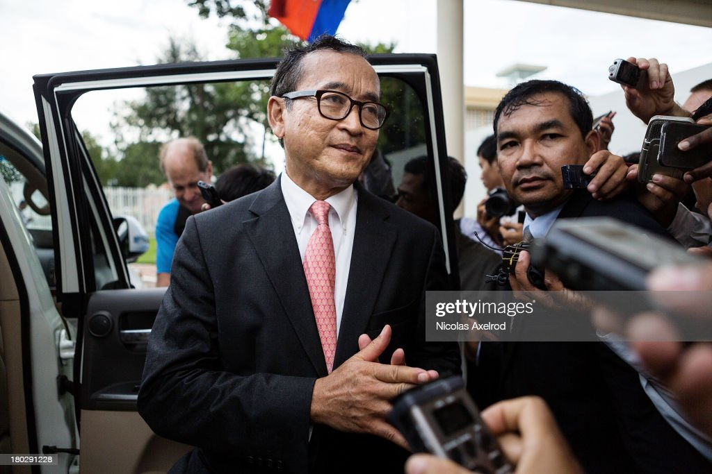 <a gi-track='captionPersonalityLinkClicked' href=/galleries/search?phrase=Sam+Rainsy&family=editorial&specificpeople=660347 ng-click='$event.stopPropagation()'>Sam Rainsy</a> president of the Cambodia National Rescue Party talks to members of the press at the Phnom Penh airport after he welcomed King Norodom Sihamoni on his return to Cambodia on September 11, 2013 in Phnom Penh, Cambodia. King Norodom Sihamoni returns to Cambodia amid election controversy and has been asked by the opposition leader to intervene in the election dispute. The King had been in China where it is said he was receiving a medical check up.