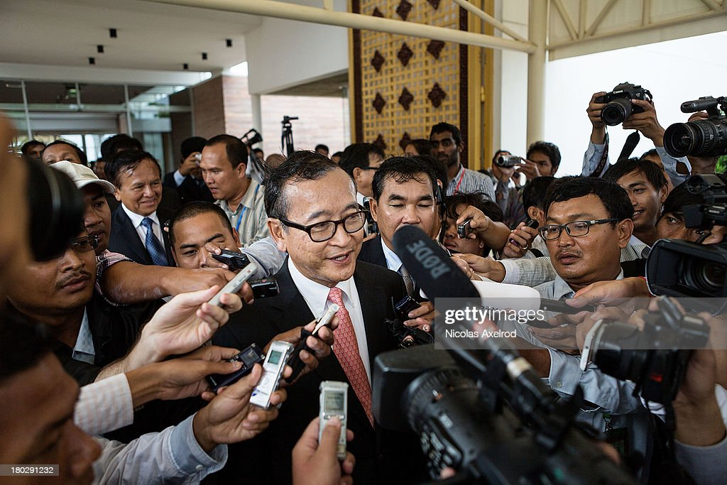 Sam Rainsy president of the Cambodia National Rescue Party talks to members of the press at the Phnom Penh airport after he welcomed King Norodom...
