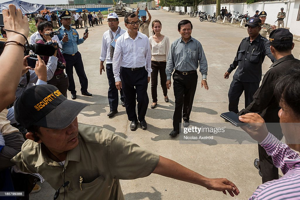 <a gi-track='captionPersonalityLinkClicked' href=/galleries/search?phrase=Sam+Rainsy&family=editorial&specificpeople=660347 ng-click='$event.stopPropagation()'>Sam Rainsy</a> (L), President of the CNRP and <a gi-track='captionPersonalityLinkClicked' href=/galleries/search?phrase=Kem+Sokha&family=editorial&specificpeople=659005 ng-click='$event.stopPropagation()'>Kem Sokha</a> (C), Vice-President of the CNRP leave the Russian Embassy on October 25, 2013 in Phnom Penh, Cambodia. The Cambodian National Rescue Party hold the last day of a three day protest in commemoration of the 22nd anniversary of the October 23, 1991 Paris Peace Accords. The CNRP delivered letters to the Australian, Russian, Japanese, Indonesian and Chinese Embassies asking to pressure the Cambodian government to resolving the current political deadlock caused by a dispute over the country's July elections.