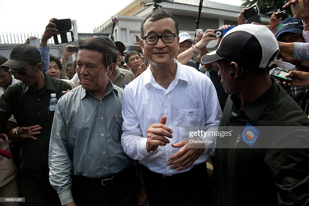 Sam Rainsy (C), President of the CNRP and the party's Vice President Kem Sokha (L) leave the Chinese Embassy on October 25, 2013 in Phnom Penh, Cambodia. Today is the last day of a three day protest held by the Cambodian National Rescue Party hold in commemoration of the 22nd anniversary of the October 23, 1991 Paris Peace Accords. The CNRP delivered letters to the Australian, Russian, Japanese, Indonesian and Chinese Embassies asking them to put pressure on the Cambodian government to resolve the current political deadlock caused by a dispute over the country's July elections.