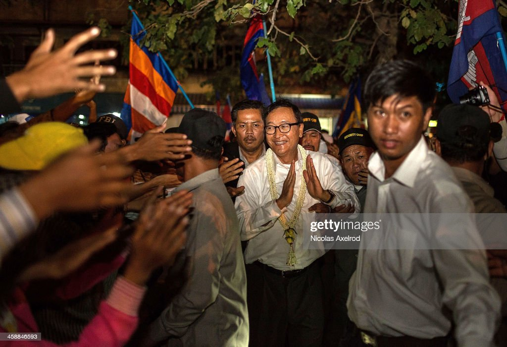 Sam Rainsy President of the CNRP arrives at Freedom Park after leading a group of protesters on December 22 2013 in Phnom Penh Cambodia Following a...
