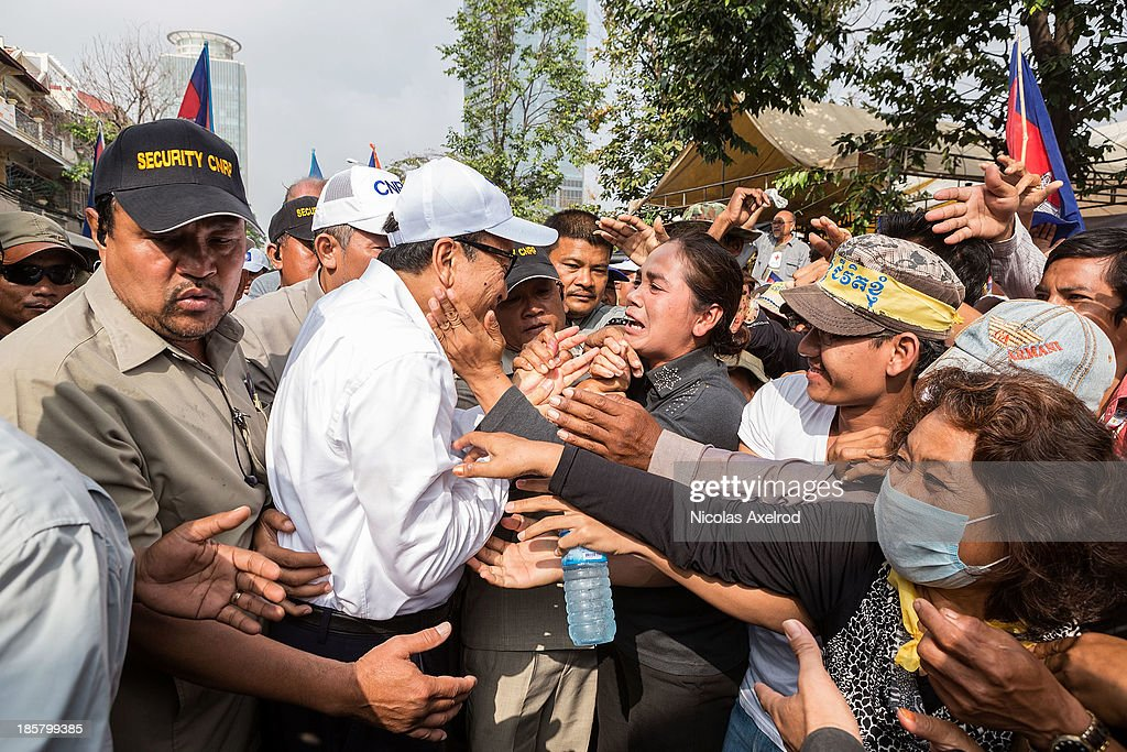 <a gi-track='captionPersonalityLinkClicked' href=/galleries/search?phrase=Sam+Rainsy&family=editorial&specificpeople=660347 ng-click='$event.stopPropagation()'>Sam Rainsy</a> (C), President of the CNRP is greeted by supporters at Freedom Park on October 25, 2013 in Phnom Penh, Cambodia. The Cambodian National Rescue Party hold the last day of a three day protest in commemoration of the 22nd anniversary of the October 23, 1991 Paris Peace Accords. The CNRP delivered letters to the Australian, Russian, Japanese, Indonesian and Chinese Embassies asking to pressure the Cambodian government to resolving the current political deadlock caused by a dispute over the country's July elections.