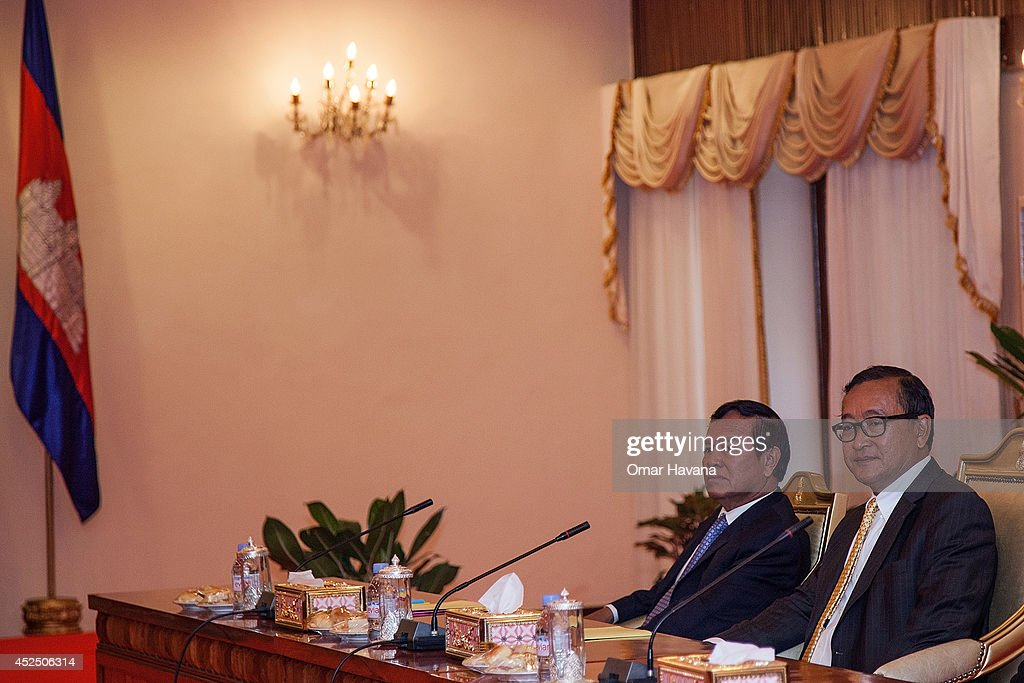 Sam Rainsy President of the opposition Cambodia National Rescue Party and Kem Sokha VicePresident of the CNRP sit in one of the Senate rooms moments...