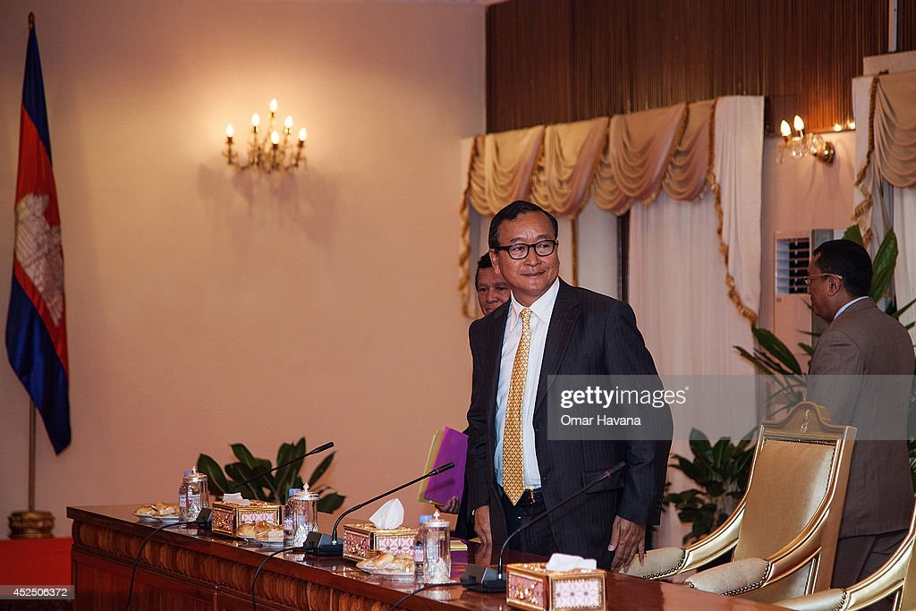 Sam Rainsy President of the opposition Cambodia National Rescue Party stands in one of the Senate rooms moments ahead of a meeting aimed at resolving...