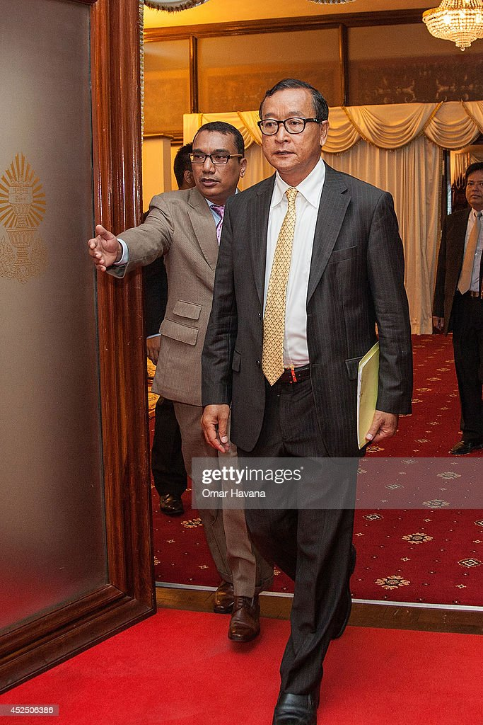 Sam Rainsy President of the opposition Cambodia National Rescue Party arrives at the Cambodian Senate for a meeting with Cambodian Prime Minister Hun...