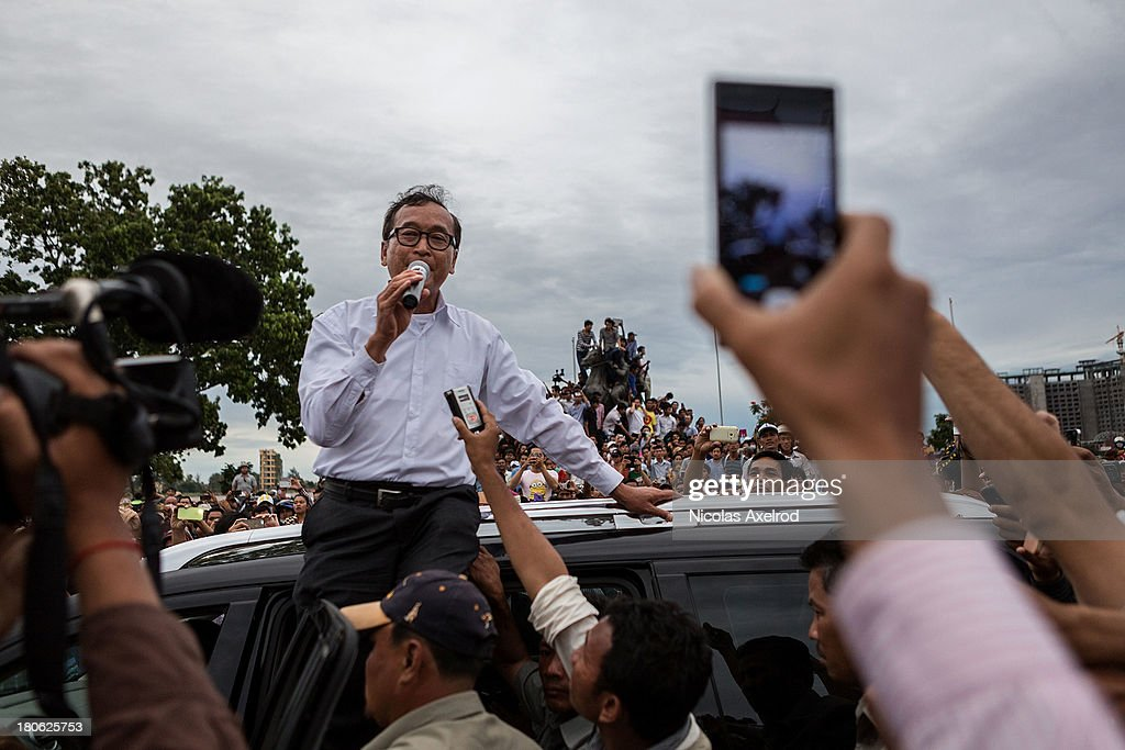 Sam Rainsy talks to people after clashes were dissipated near the riverside on September 15, 2013 in Phnom Penh, Cambodia. The CNRP plan a three day demonstration to contest the Cambodian national election results.