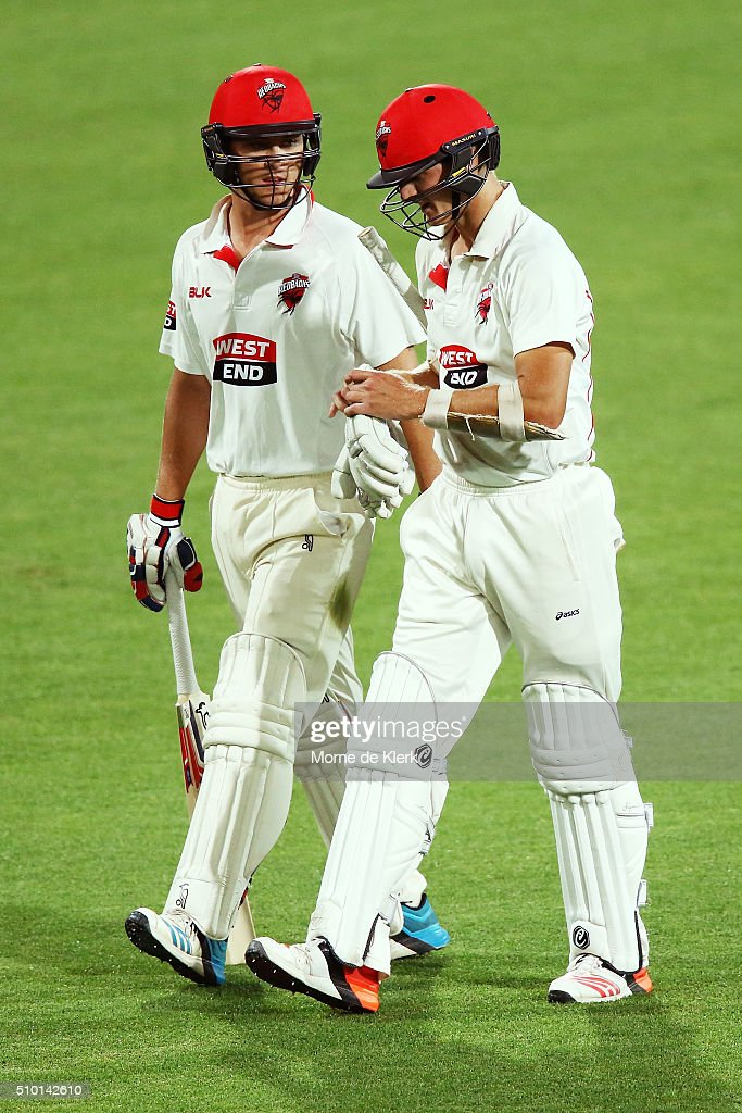 Sam Raphael and Joe Mennie of the Redbacks leave the field at the end of play during day one of the Sheffield Shield match between South Australia and Victoria at Adelaide Oval on February 14, 2016 in Adelaide, Australia.