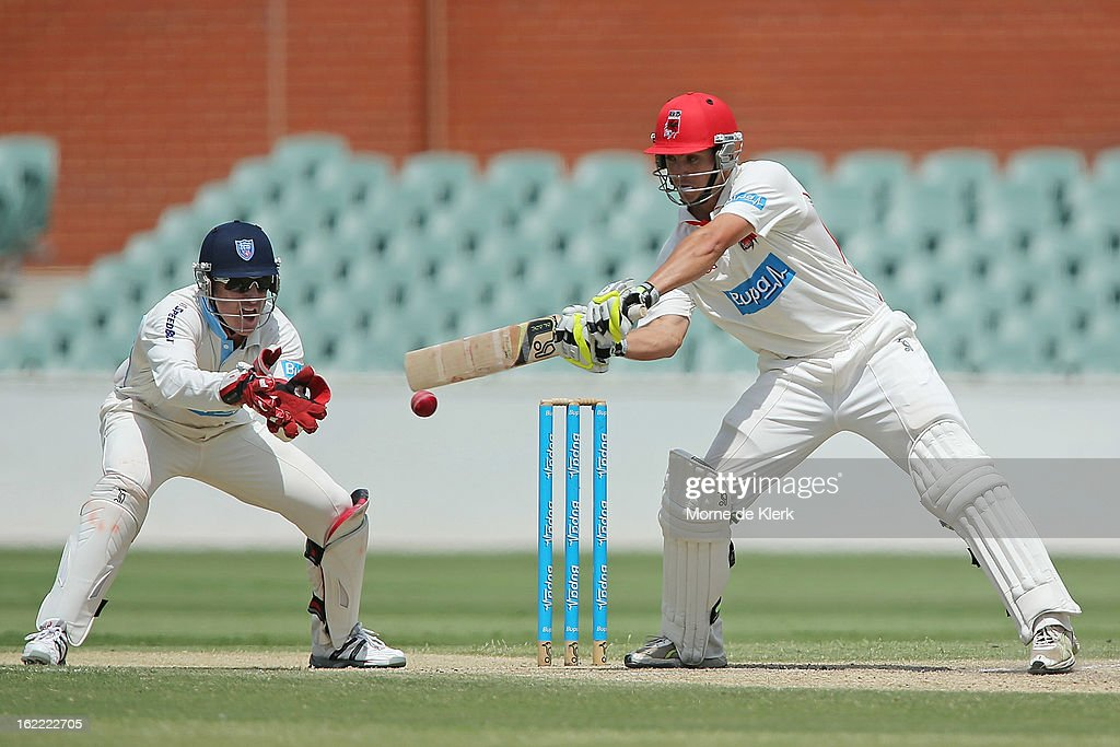 Sam Raphael of the Redbacks bats in front of <a gi-track='captionPersonalityLinkClicked' href=/galleries/search?phrase=Brad+Haddin&family=editorial&specificpeople=193800 ng-click='$event.stopPropagation()'>Brad Haddin</a> of the Blues during day three of the Sheffield Shield match between the South Australian Redbacks and the New South Wales Blues at Adelaide Oval on February 21, 2013 in Adelaide, Australia.