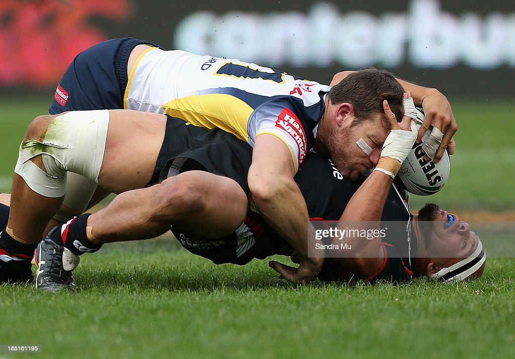 Sam Rapira of the Warriors is tackled by Gavin Cooper of the Cowboys during the round four NRL match between the New Zealand Warriors and the North Queensland Cowboys at Mt Smart Stadium on April 1, 2013 in Auckland, New Zealand.