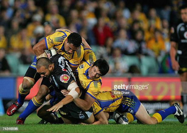 Sam Rapira of the Warriors is tackled by the Eels defence during the round 11 NRL match between the Parramatta Eels and the Warriors at Parramatta...