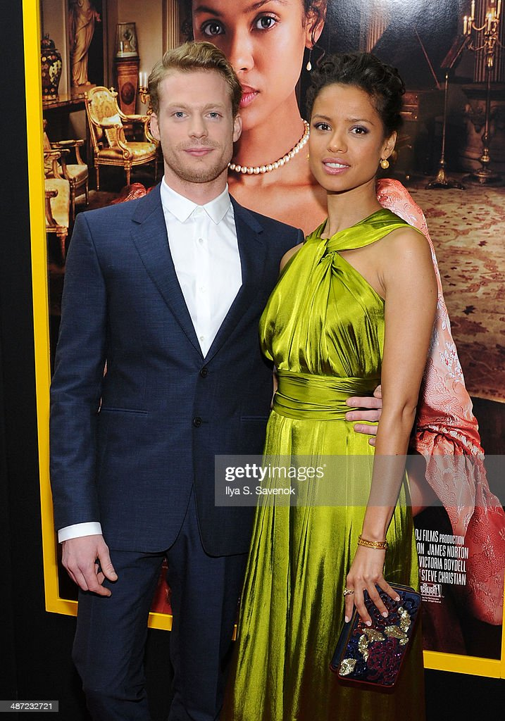 Sam Reid and <a gi-track='captionPersonalityLinkClicked' href=/galleries/search?phrase=Gugu+Mbatha-Raw&family=editorial&specificpeople=5897973 ng-click='$event.stopPropagation()'>Gugu Mbatha-Raw</a> attend the 'Belle' premiere at The Paris Theatre on April 28, 2014 in New York City.