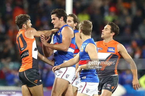 Sam Reid of the Giants clashes with Tom Boyd of the Bulldogs during the round six AFL match between the Greater Western Sydney Giants and the Western...