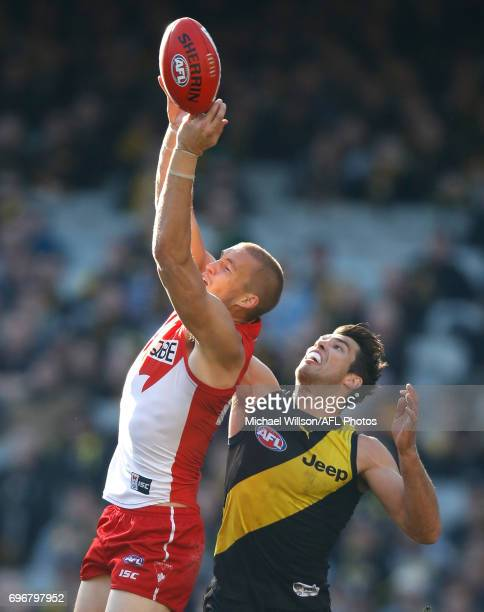 Sam Reid of the Swans and Alex Rance of the Tigers compete for the ball during the 2017 AFL round 13 match between the Richmond Tigers and the Sydney...