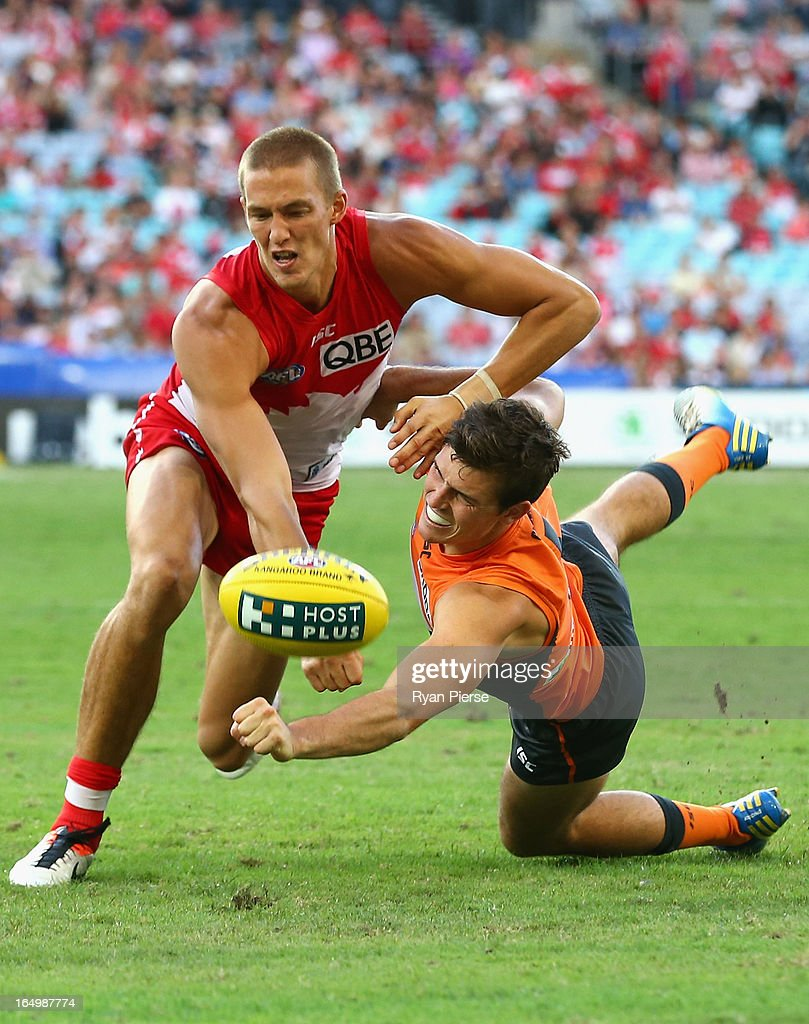 Sam Reid of the Swans competes for the ball against Phil Davis of the Giants during the round one AFL match between the Greater Western Sydney Giants and the Sydney Swans at ANZ Stadium on March 30, 2013 in Sydney, Australia.