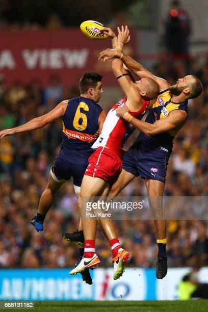 Sam Reid of the Swans contests for a mark against Elliot Yeo and Will Schofield of the Eagles during the round four AFL match between the West Coast...