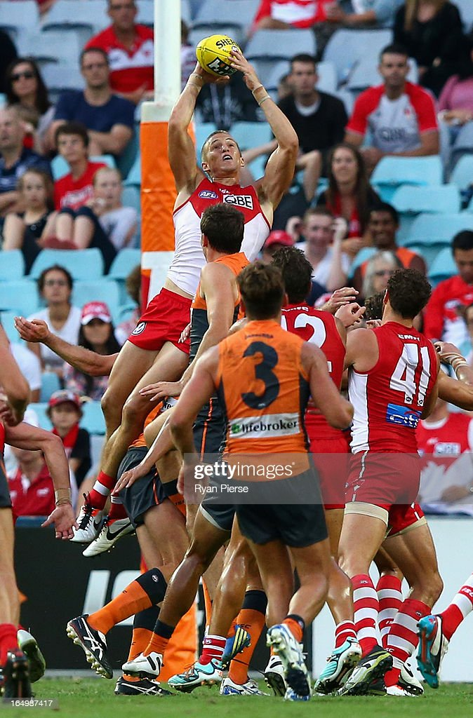 Sam Reid of the Swans takes a high mark during the round one AFL match between the Greater Western Sydney Giants and the Sydney Swans at ANZ Stadium on March 30, 2013 in Sydney, Australia.