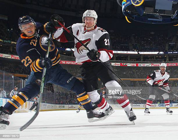 Sam Reinhart of the Buffalo Sabres battles for position with Oliver EkmanLarsson of the Arizona Coyotes during an NHL game on December 4 2015 at the...