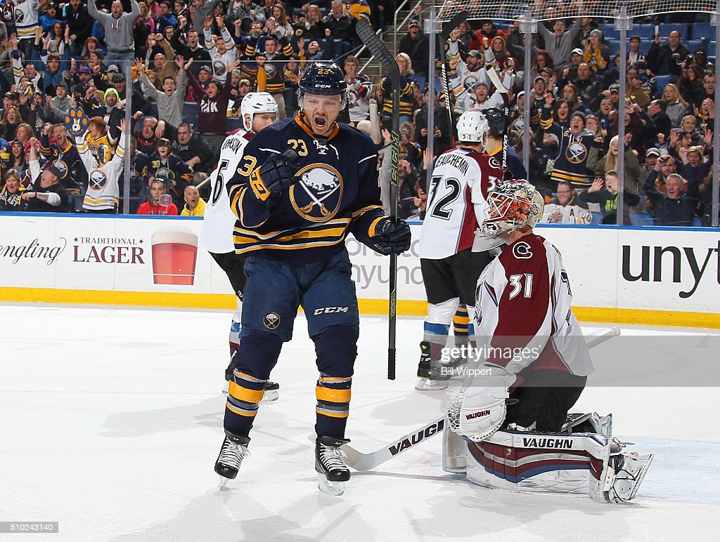 <a gi-track='captionPersonalityLinkClicked' href=/galleries/search?phrase=Sam+Reinhart&family=editorial&specificpeople=9984450 ng-click='$event.stopPropagation()'>Sam Reinhart</a> #23 of the Buffalo Sabres celebrates a first period goal against <a gi-track='captionPersonalityLinkClicked' href=/galleries/search?phrase=Calvin+Pickard&family=editorial&specificpeople=6698843 ng-click='$event.stopPropagation()'>Calvin Pickard</a> #31 of the Colorado Avalanche during an NHL game on February 14, 2016 at the First Niagara Center in Buffalo, New York.