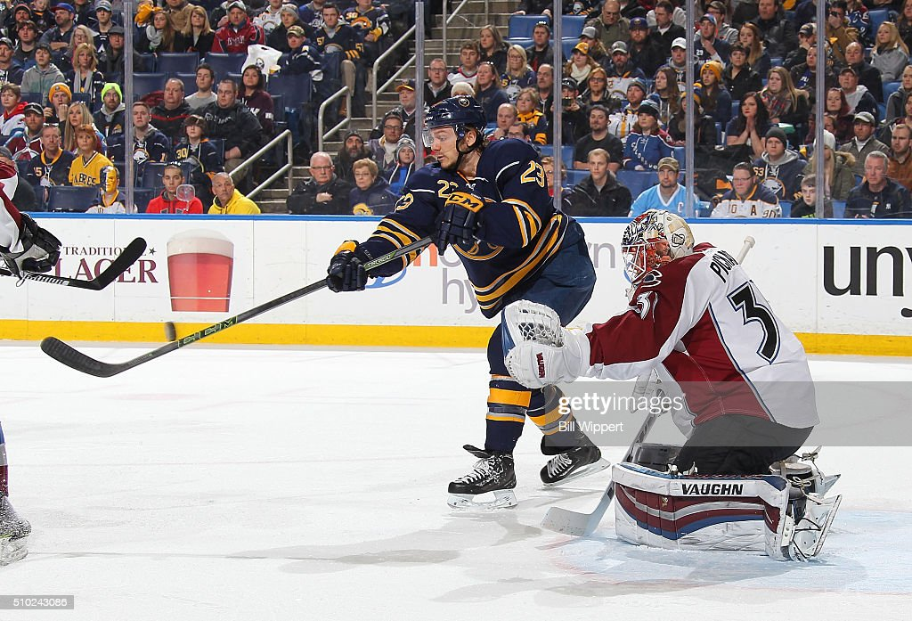 <a gi-track='captionPersonalityLinkClicked' href=/galleries/search?phrase=Sam+Reinhart&family=editorial&specificpeople=9984450 ng-click='$event.stopPropagation()'>Sam Reinhart</a> #23 of the Buffalo Sabres deflects the puck past <a gi-track='captionPersonalityLinkClicked' href=/galleries/search?phrase=Calvin+Pickard&family=editorial&specificpeople=6698843 ng-click='$event.stopPropagation()'>Calvin Pickard</a> #31 of the Colorado Avalanche for a first period goal during an NHL game on February 14, 2016 at the First Niagara Center in Buffalo, New York.