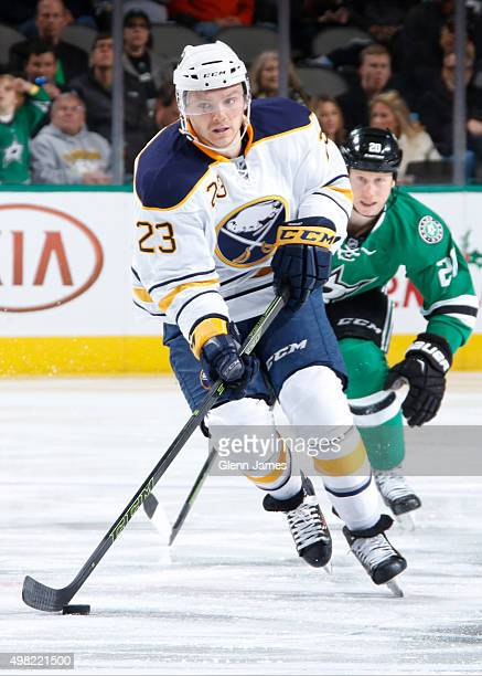 Sam Reinhart of the Buffalo Sabres handles the puck against the Dallas Stars at the American Airlines Center on November 21 2015 in Dallas Texas