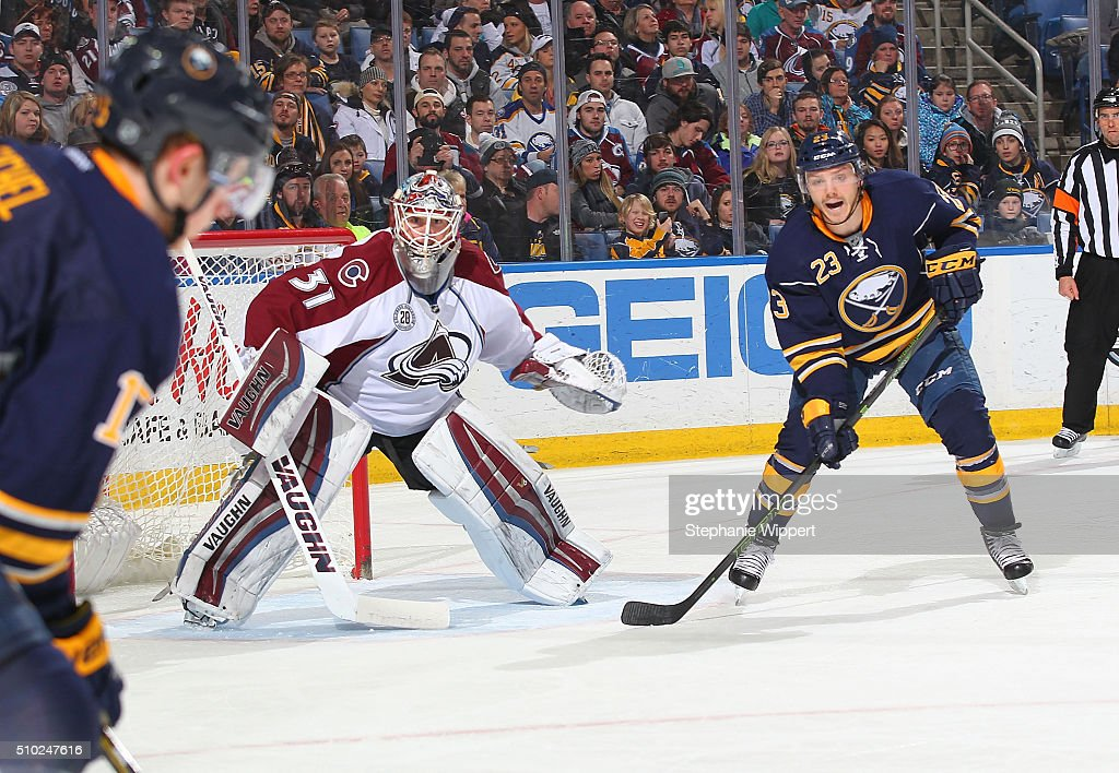 Sam Reinhart #23 of the Buffalo Sabres shouts for a pass from Jack Eichel #15 in front of goaltender Calvin Pickard #31 of the Colorado Avalanche during an NHL game on February 14, 2016 at the First Niagara Center in Buffalo, New York.