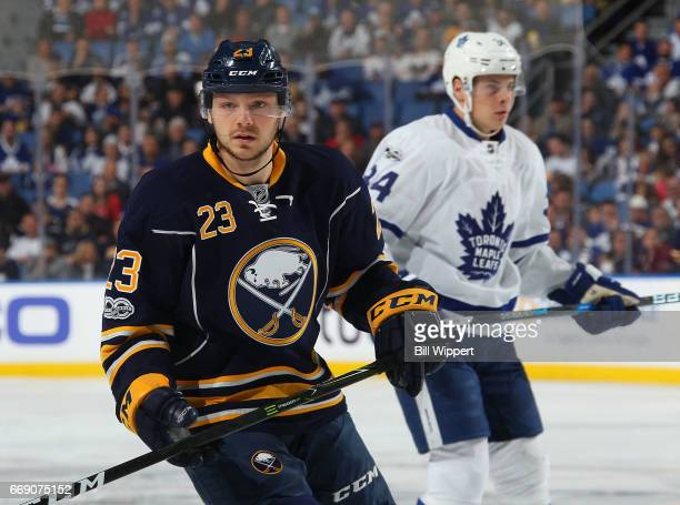 Sam Reinhart of the Buffalo Sabres skates against Auston Matthews of the Toronto Maple Leafs during an NHL game at the KeyBank Center on April 3 2017...
