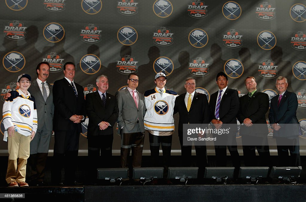 Sam Reinhart poses with team personnel after being selected second overall by the Buffalo Sabres during the 2014 NHL Entry Draft at Wells Fargo Center on June 27, 2014 in Philadelphia, Pennsylvania.