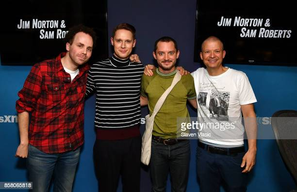 Sam Roberts Samuel Barnett Elijah Wood and Jim Norton pose for a photo at ' Jim Sam' at SiriusXM Studios on October 5 2017 in New York City