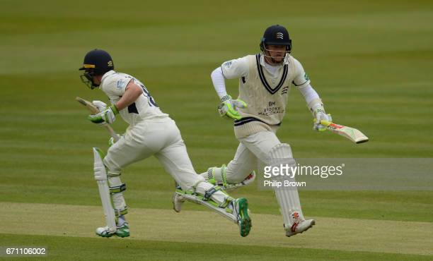 Sam Robson and Nick Gubbins of Middlesex run during day one of the Specsavers County Championship Division One cricket match between Middlesex and...