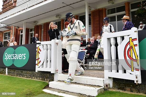 Sam Robson of Middlesex makes his way onto the field during day one of the Specsavers County Championship Division One match between Middlesex and...