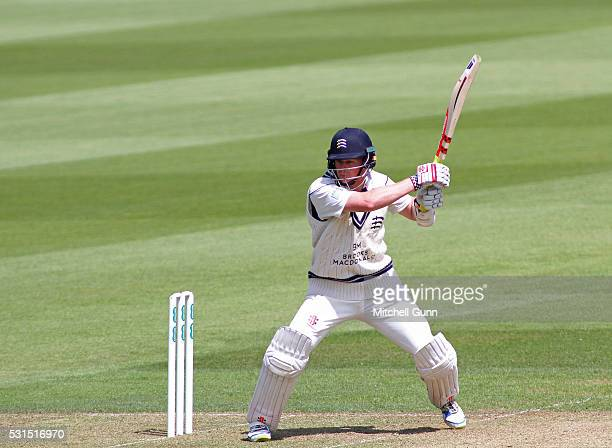 Sam Robson of Middlesex plays a shot for four runs during the Specsavers County Championship Division One match between Surrey and Middlesex at the...
