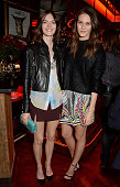 Sam Rollinson and Charlotte Wiggins attend the Vogue Christmas Party at Rififi on December 9 2014 in London England
