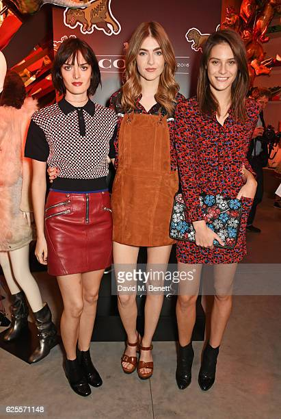 Sam Rollinson Eve Delf and Charlotte Wiggins attend the launch of Coach House Regent Street on November 24 2016 in London England