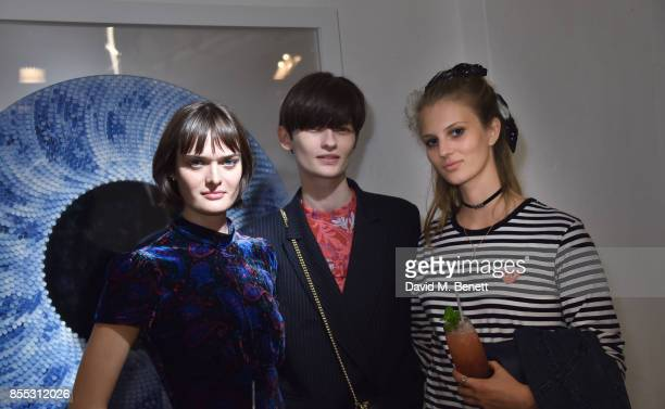 Sam Rollison Lara Mullen and Florence Kosky attend a private view of artist Chemical X's new exhibition 'CX300' at The Vinyl Factory on September 28...