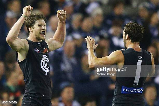 Sam Rowe of the Blues celebrates his goal with Andrew Walker during the round 12 AFL match between the Geelong Cats and the Carlton Blues at Etihad...