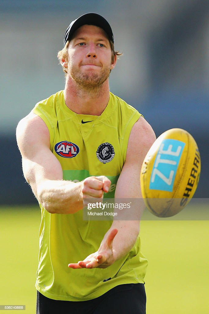 Sam Rowe of the Blues handballs during the Carlton Blues AFL training session at Ikon Park on June 1, 2016 in Melbourne, Australia.