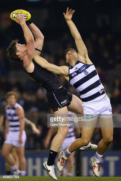 Sam Rowe of the Blues marks during the the round 21 AFL match between the Carlton Blues and the Geelong Cats at Etihad Stadium on August 15 2014 in...