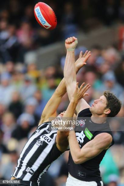 Sam Rowe of the Blues punches the ball away from Darcy Moore of the Magpies during the round seven AFL match between the Collingwood Magpies and the...