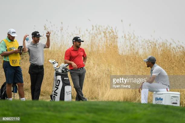 Sam Ryder Stephan Jaeger of Germany and Stephen Curry talk while waiting on the second tee during the second round of the Webcom Tour Ellie Mae...