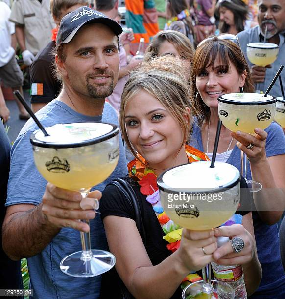 Sam Salde of SRS Fabrication his daughter Toni Salde and wife Kim Salde hold margaritas during the grand opening celebration for the Margaritaville...