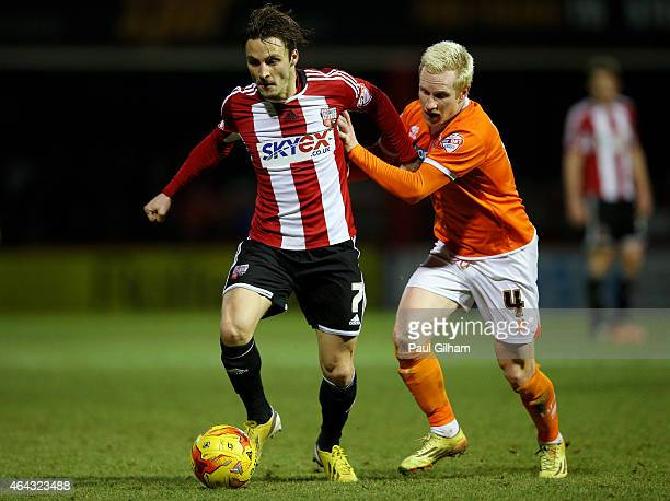 Sam Saunders of Brentford holds off the challenge from David Perkins of Blackpool during the Sky Bet Championship match between Brentford and...