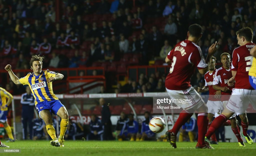 Sam Saunders (L) of Brentford scores the opening goal during the Sky Bet League One match between Bristol City and Brentford at Ashton Gate on October 22, 2013 in Bristol, England.